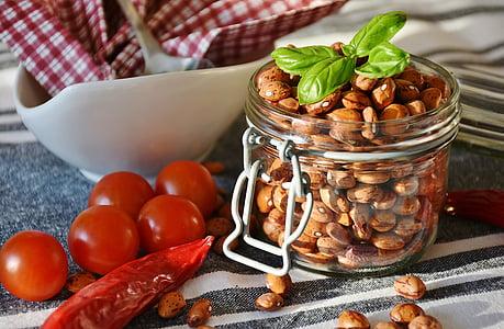 brown peanuts in glass jar