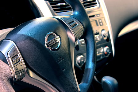 black Nissan steering wheel on focus photo