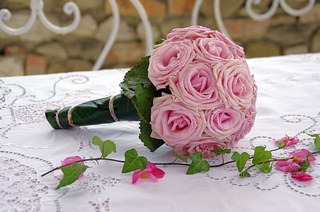 bouquet of pink roses on white table top