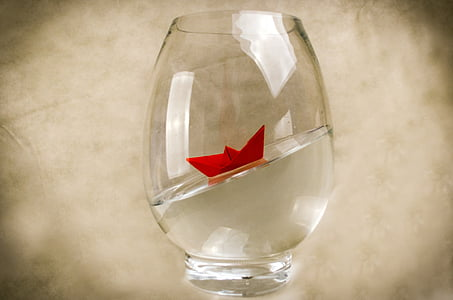 clear glass with red origami inside