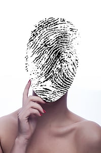 black and white finger print on person's face