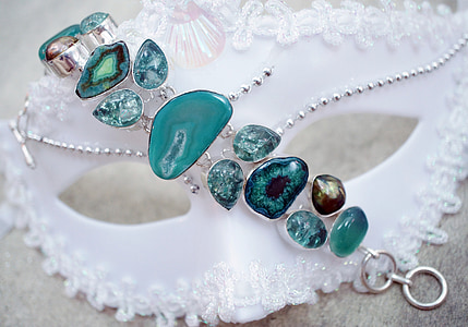 silver-colored jewelry with teal gemstones
