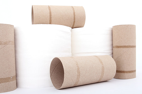 toilet paper and rolls on white surface