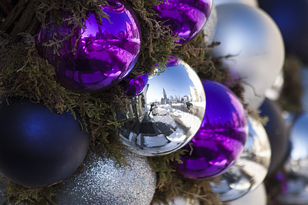 purple and gray Christmas baubles mounted on tree