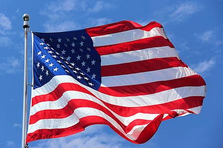 flag of USA hanging on pole