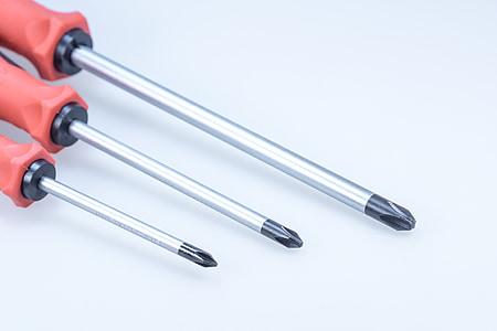 three gray-and-black screwdrivers