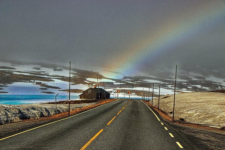 road horizon with rainbow