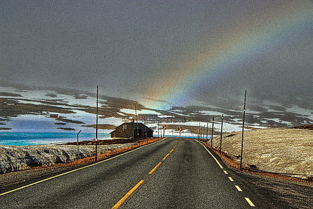 road horizon with rainbow