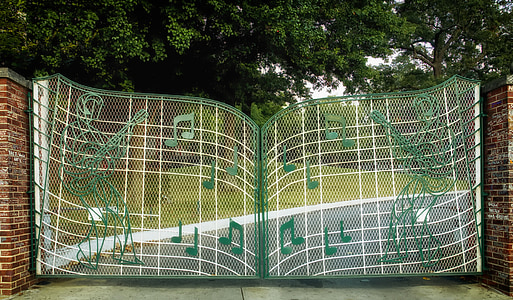 white and green metal gate