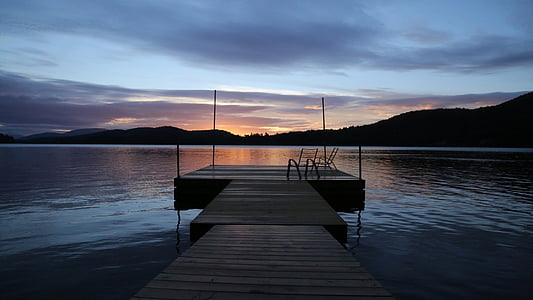 wooden dock during dawn