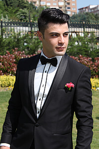 man wearing black suit jacket