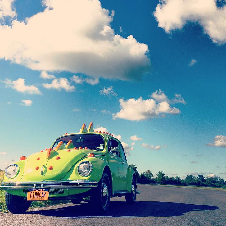 green Volkswagen Beetle on road