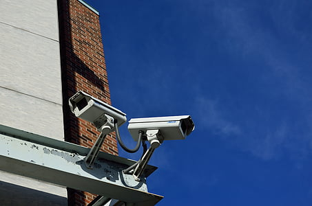 two white surveillance camera