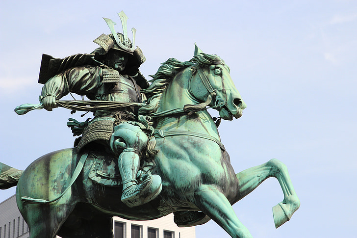 man riding on horse statuette