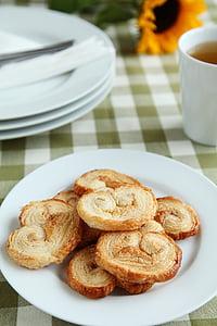 photo of baked food on plate near mug