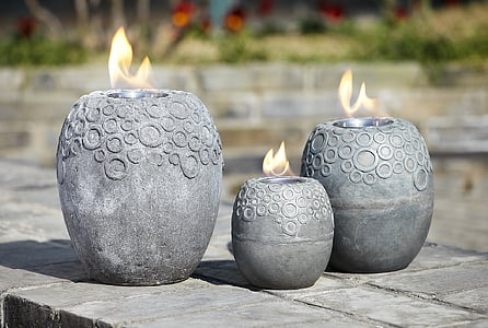 selective focus photography of vase candle holders