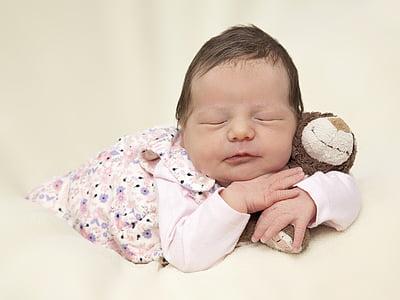close shot of baby holding plush toy
