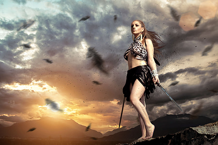 woman in black skirt holding two swords graphic wallpaper