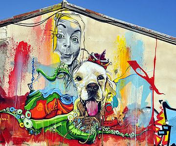photo of dog and woman wearing hijab graffiti artwork