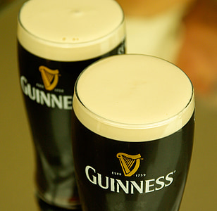 closeup photography of two Guinness pilsner glasses
