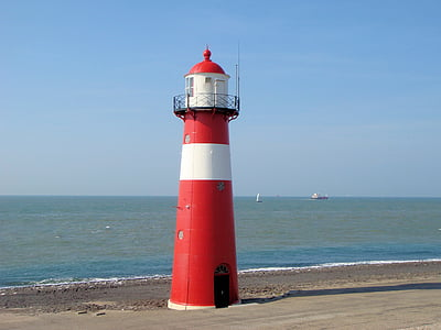 red and white lighthouse near shore