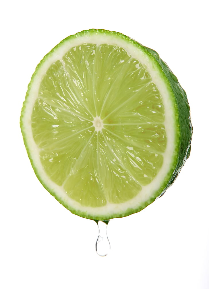 sliced green lime in macro shot photography