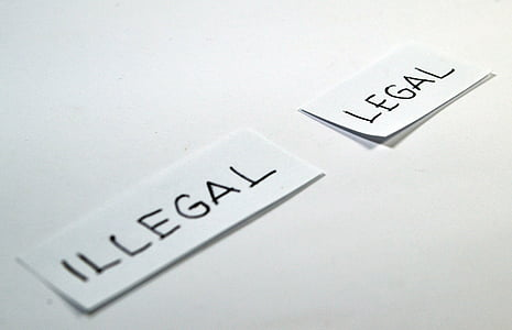 white paper with illegal and legal text