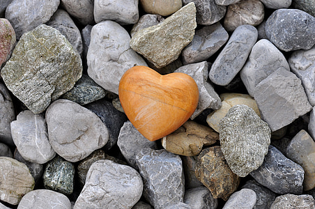 heart brown wooden box on gray stones