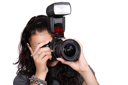 woman wearing black top holding black single-lens reflex camera