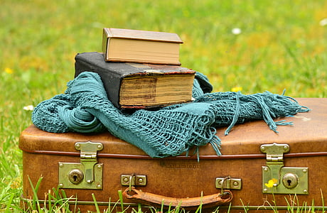 book and teal scarf on the briefcase