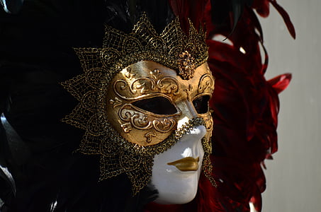 mannequin wearing gold and brown masquerade