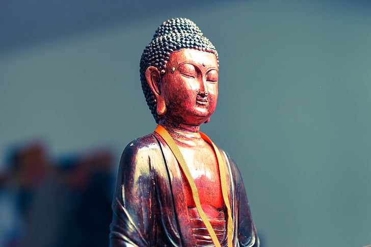 red and black Buddha figurine
