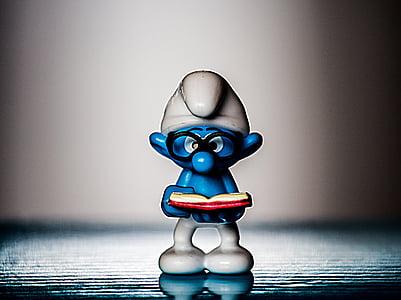 Brainy Smurf figurine on gray surface