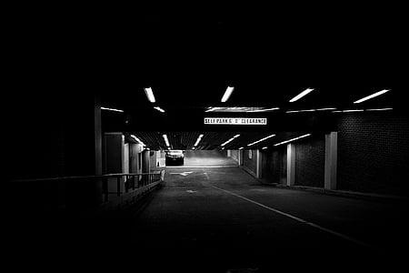 grascale photo of a parking basement