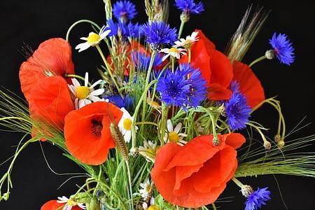 orange, white, and blue flower bouquet