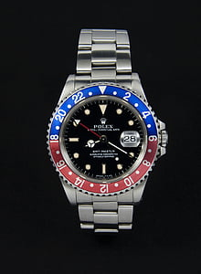 round blue and silver-colored Rolex analog watch