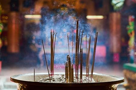 shallow focus of incense sticks