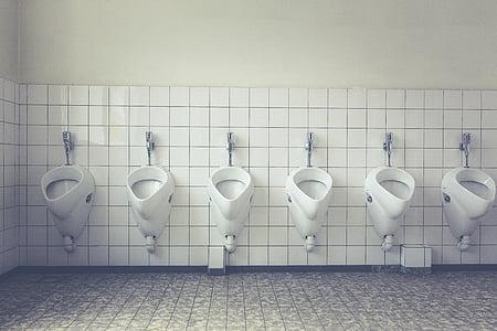 six white ceramic urinals