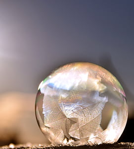 clear glass ball in shallow focus lens