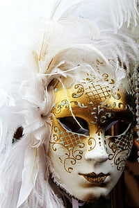 person wearing white and gold glittered cocktail mask