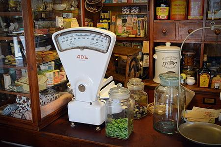 white analog scale beside clear glass mason jars