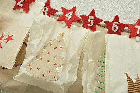 paper with numbers hanging in front of white surface
