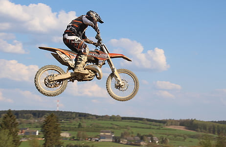 man riding on dirt bike photo