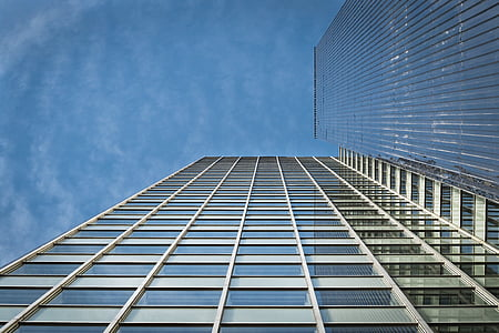 low angle photo of glass high rise building under clear blue sky