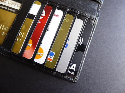 assorted-color cards on black leather wallet