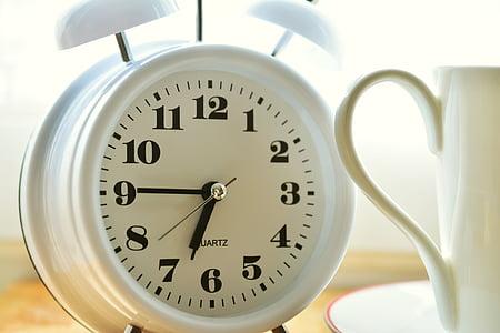 white bell alarm clock