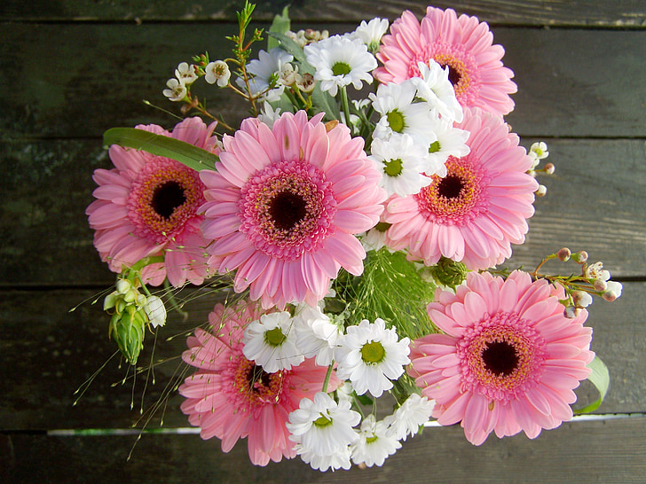 white and pink petaled flowers on desk