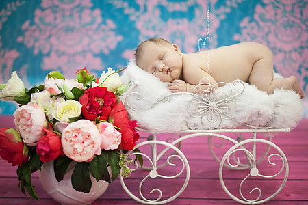 baby sleeping on top of white pram