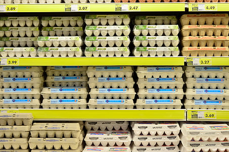 piled of egg tray on rack