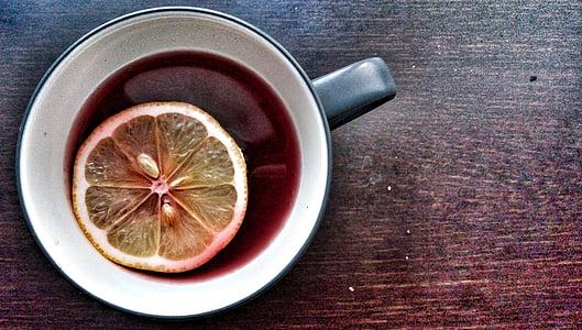 slice citrus in black mug
